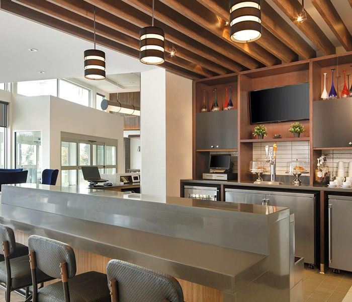 Custom wood slatted ceilings, kitchen cabinetry, wood paneling by J Suss Industries
